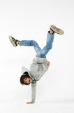 Fototapety boy dancing break dance on a white background