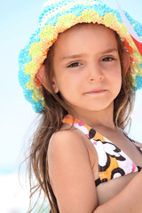Young girl in a bikini and sunhat