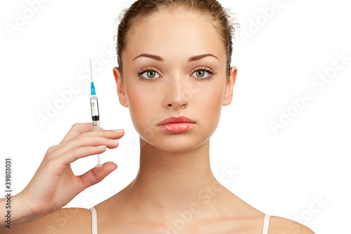 Beautiful woman with syringe in her hand