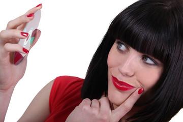 brunette with helmet haircut holding cd