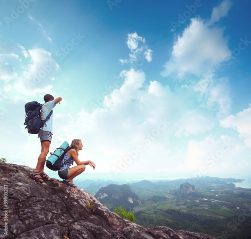 Backpackers on a rock