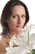 Portrait of beautiful woman smelling a flower's bouquet