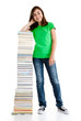 Student standing close to pile of books on white