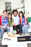 Friends supporting the Italian football team