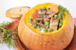 Orange pumpkin, baked whole with vegetables, mushrooms and meat