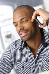 Handsome office worker on mobile call