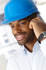Man in hardhat on call