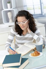College student studying at breakfast
