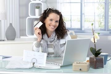 Happy woman shopping on Internet