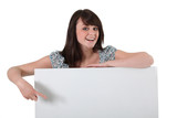 woman with a board left blank for your message