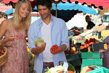 Couple choosing vegetables at the market