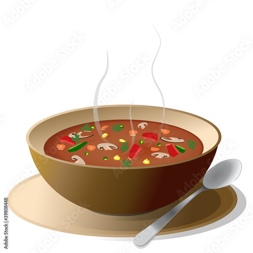 Bowl of hot vegetable soup on plate