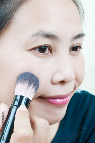 Close up Asian young woman make up.