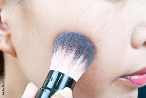Close up Asian young woman make up.