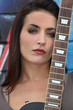 Brunette woman with a guitar neck