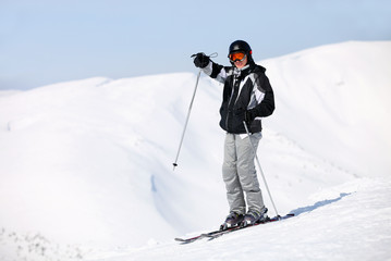 Young male skier pointing at something