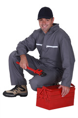 Worker sitting on a toolbox