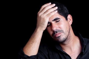 Hispanic man worried or having a headache