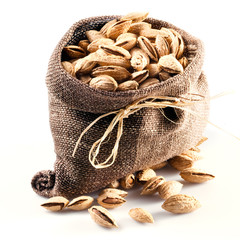 almond; nuts in bag. white background