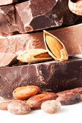 variety of chocolate. pieces with cocoa beans and almond nuts