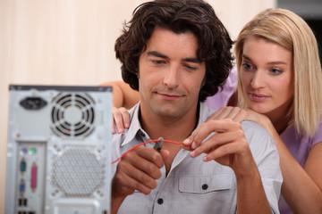Young repairing computer