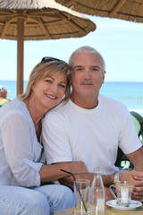 senior couple on beach terrace