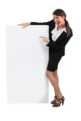 Businesswoman with advertising board