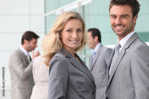 Businessman and woman smiling