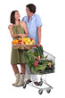 portrait of a couple buying fruit and vegetables