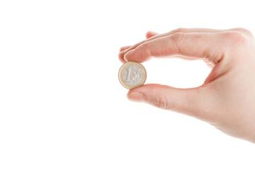 Female hand holding an euro coin