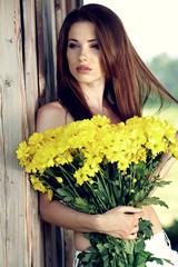 Beautiful woman among spring blossom.