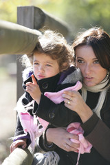Woman and daughter outdoors