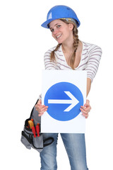 Woman holding traffic sign