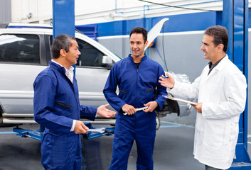 Group of mechanics talking