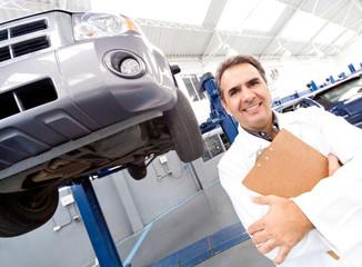 Happy mechanic smiling