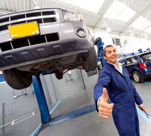 Happy mechanic with thumbs-up