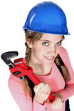 A female construction worker holding a wrench.