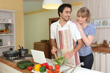 Young man making a salad with his partner