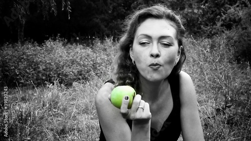 Black & White Woman eats green apple / SELECTIVE COLOR