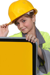 Little girl dressed as road side worker