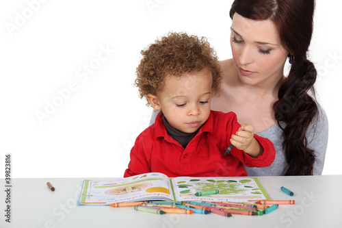 Mother encouraging creative toddler