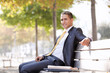 Businessman sit in the bench park