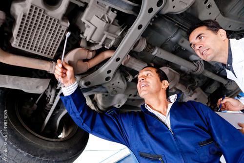 Mechanics fixing a car
