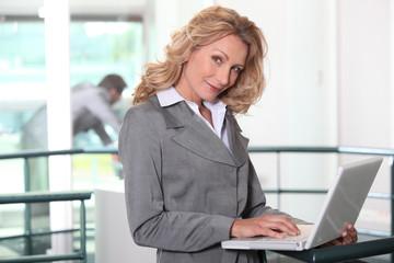 Businesswoman working on her laptop