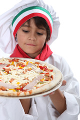 Young boy pretending to a be a pizza maker