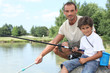 Father and son on a fishing trip at a lake