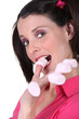 Woman eating marshmallows off her fingers