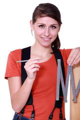 Woman using a carpenter's ruler