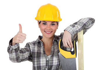A female carpenter giving the thumb up.