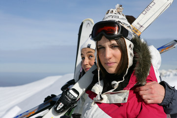 Two woman having a good time on skiing holiday